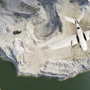 samolot bezzałogowy Koliber SURVEY podczas lotu na kopalnią